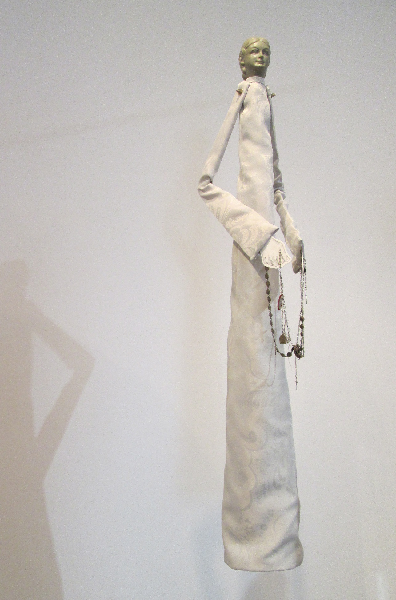 "But what's its value?;  Cast rubber, fabric, paper, graphite, beads, old rosaries; 45""h x 9""w x 13""d; 2015"