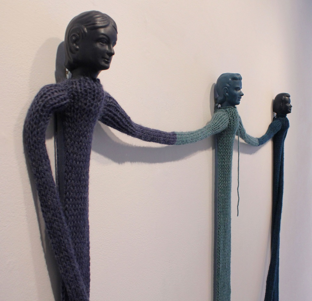 "One, then another, sometimes two (detail); Cast rubber, yarn; 68""h x 50""w x 3""d; 2012"