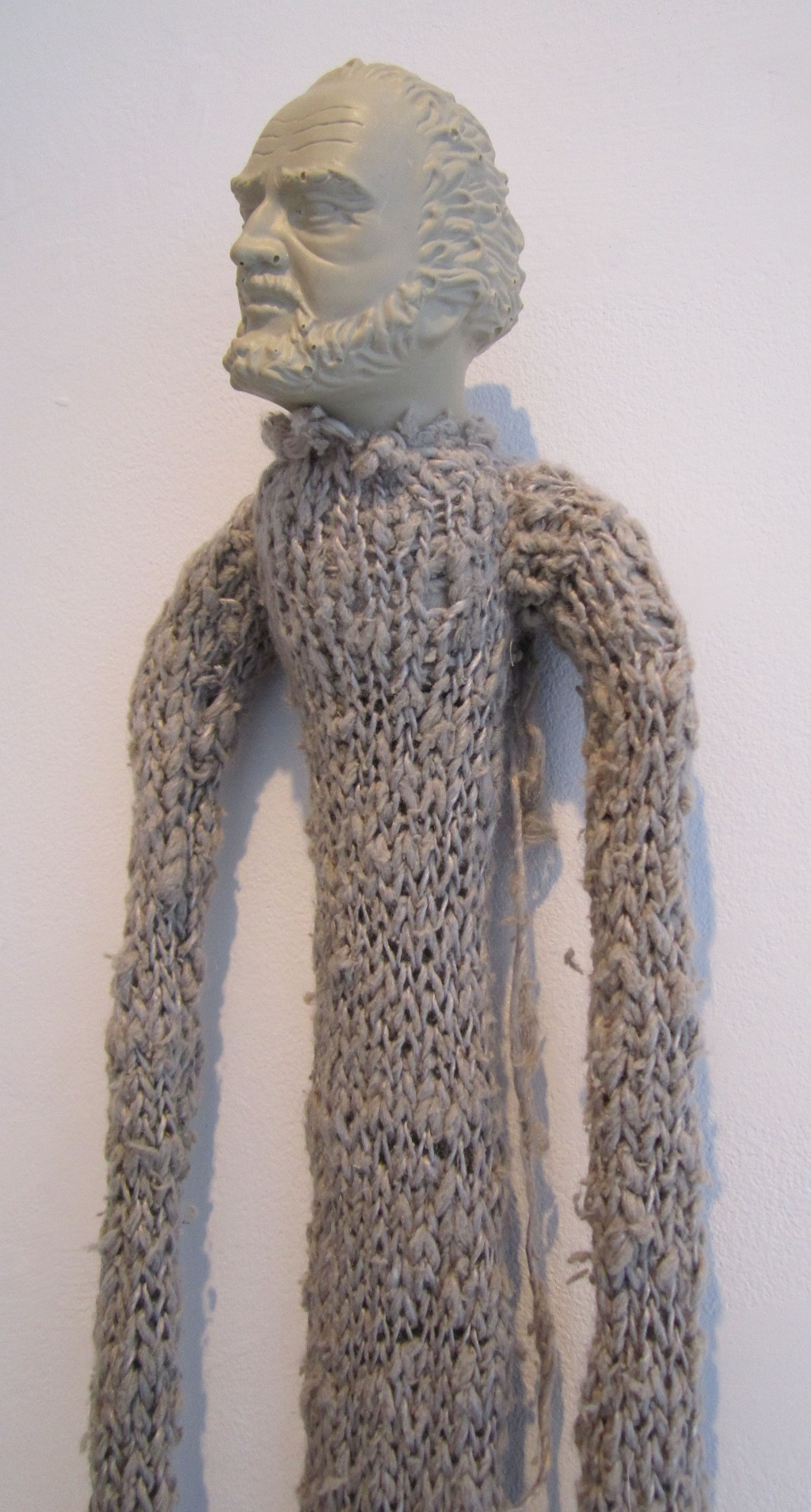 "Something's wrong. Arms too long? Hands too big? (detail); Cast rubber, yarn, paper, graphite; 60""h x 7""w x 3""d; 2012"