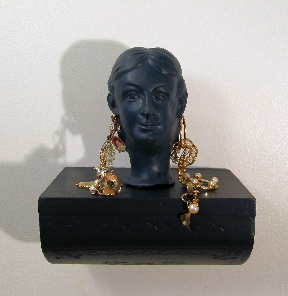 "These cost a lot; Cast rubber, costume jewelry, wooden box, acrylics; 7""h x 6""w x 5""d; 2014"