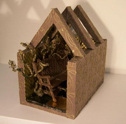 "Some Future; Wood, paper, wire, thread, found glass tiles and toy brass bench; 7""h x 4.25""w x 6.75""d; 2006"