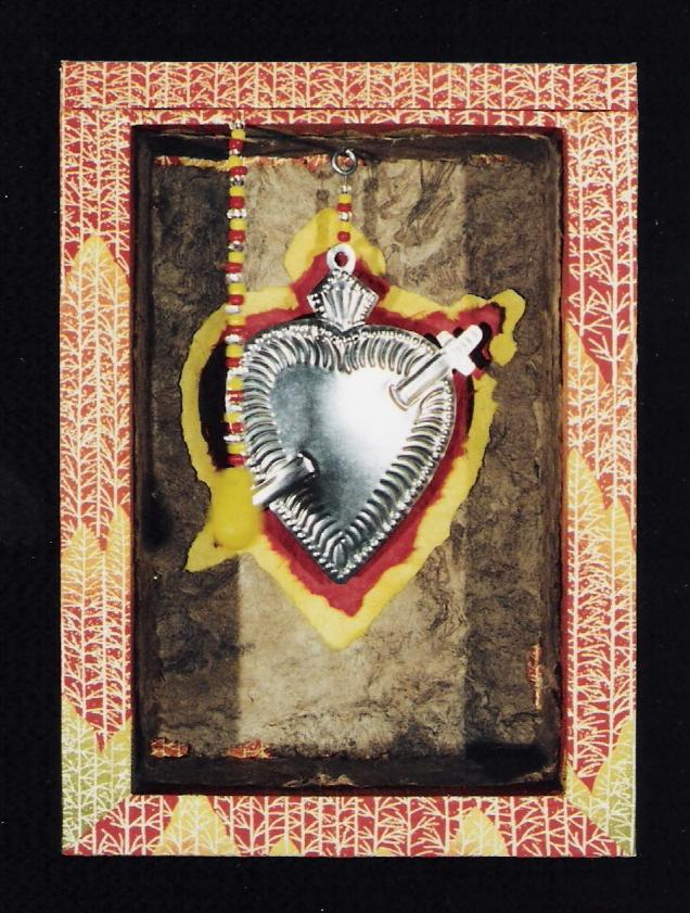 "Oh You Sacred Heart; Wood, paper, bark, tin milagro, beads; 9""h x 6.5""w x 3.5""d; 2001"